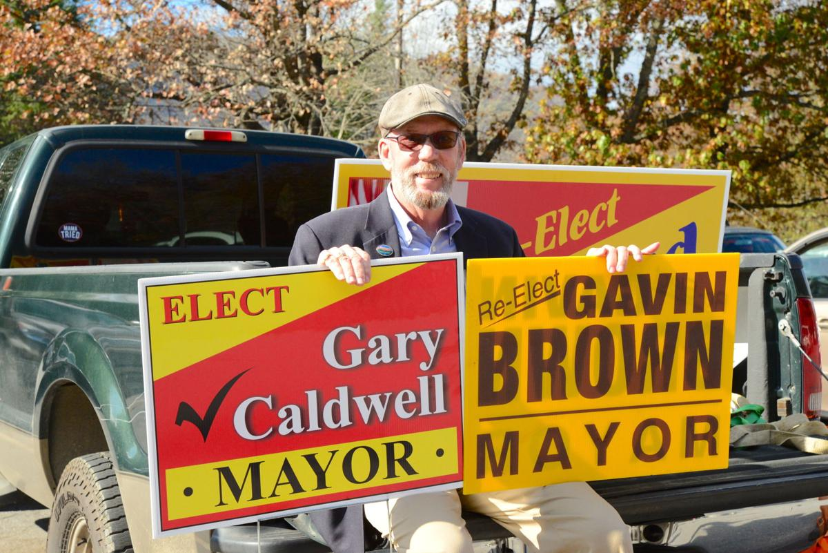 gavin brown at polls with two signs.JPG