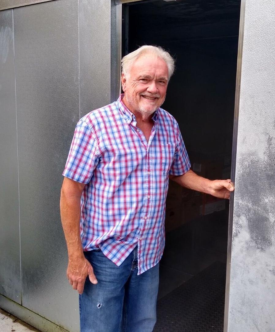 Dave Bryan at food cooler.jpg