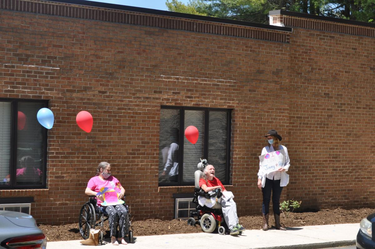 Haywood Nursing and Rehabilitation residents and staff line sidewalk for parade
