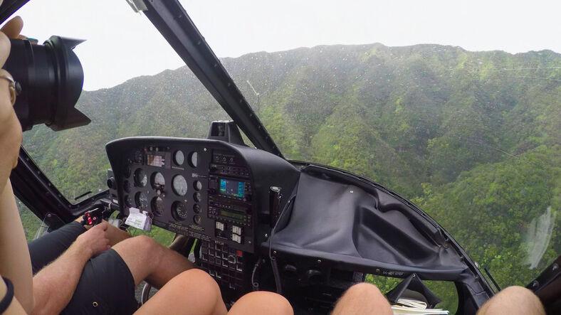 AERIAL: Helicopter flying towards stunning vast mountain range.