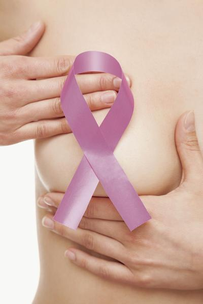 Woman with a breast cancer awareness ribbon