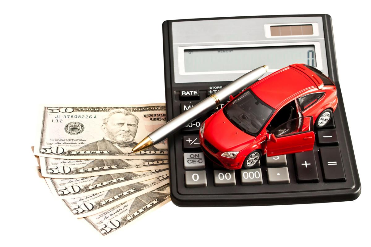 Car, money and calculator over white