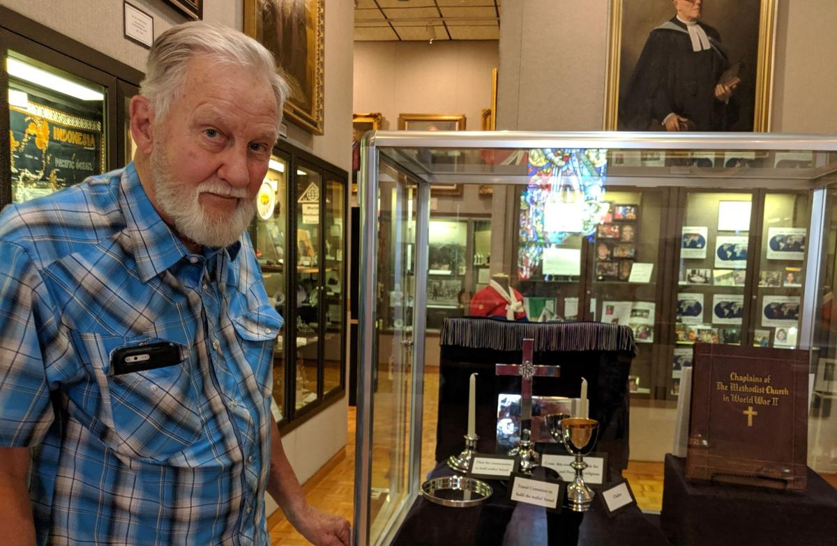 Former Paratrooper Lyndon Smathers with the Chaplains' Display