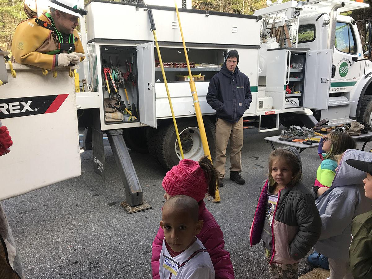 JVE Students  with  bucket truck Haywood EMC