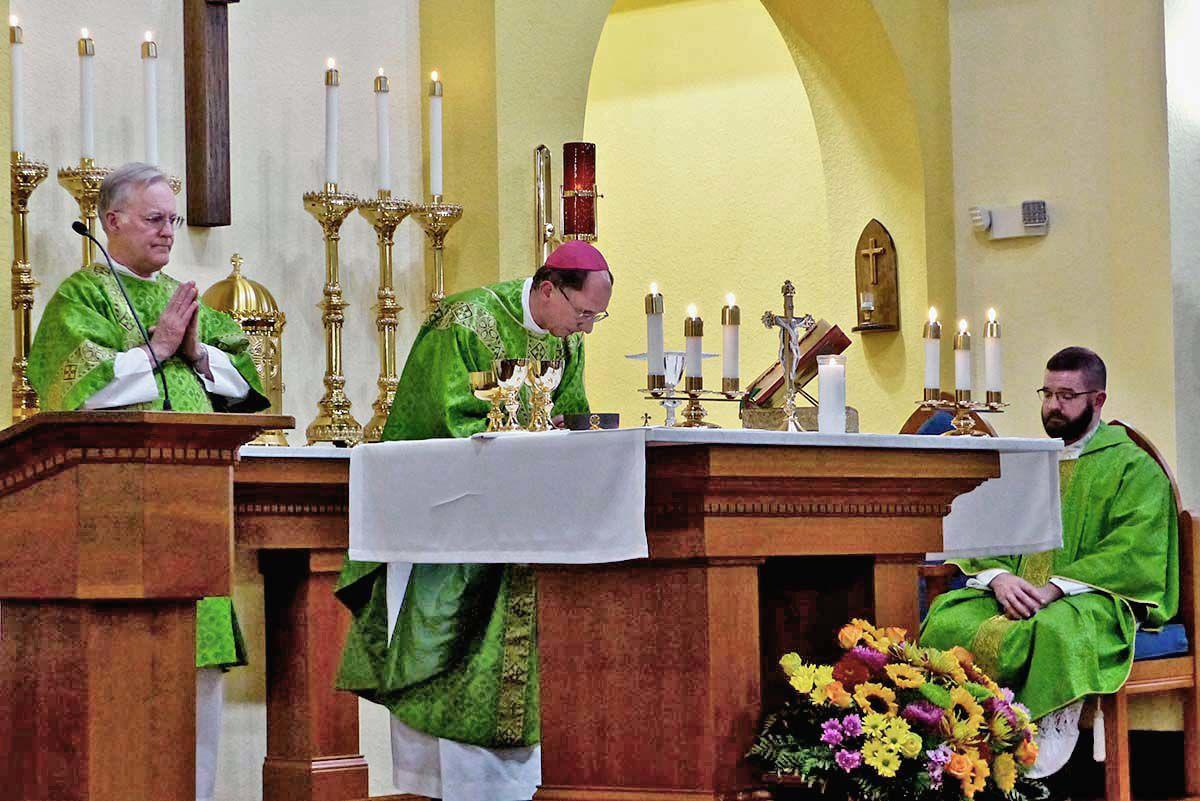 Bishop Jugis saying Mass with Deacon McNulty and Fr. McNulty