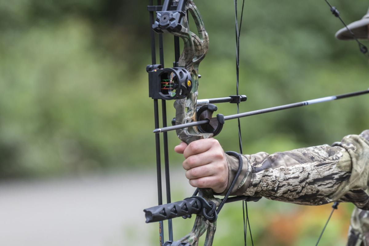 Someone Holding a Compound Hunting Bow and Arrow