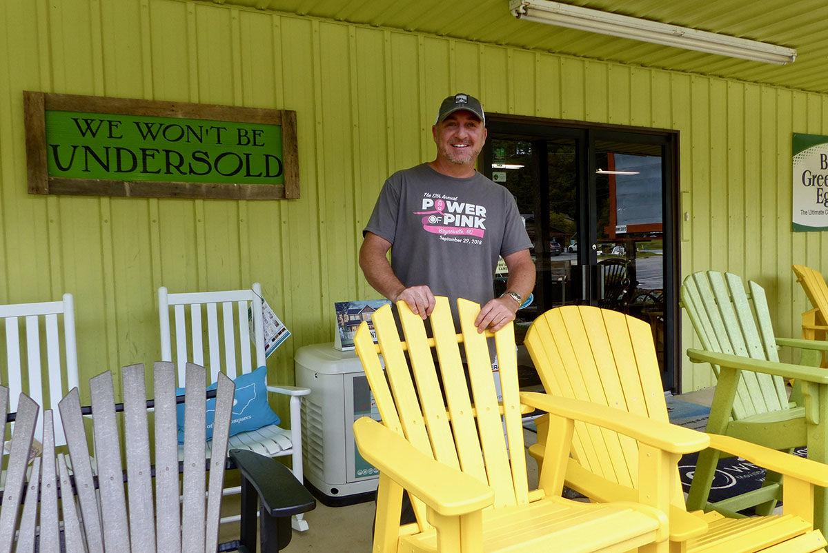 Travis Bramlett Hot Tub Store and More owner with outdoor furniture