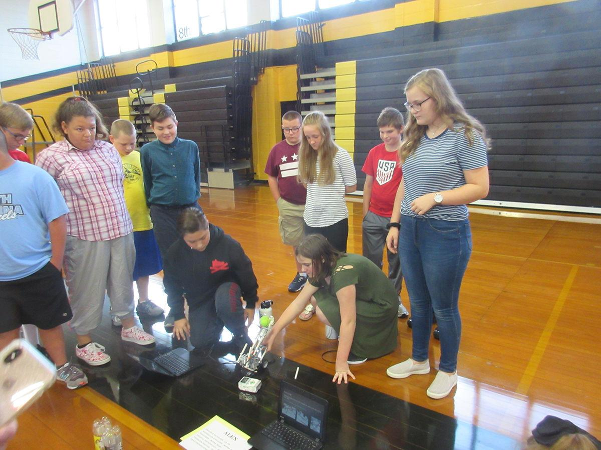 WMS students showing robot to Incredibles