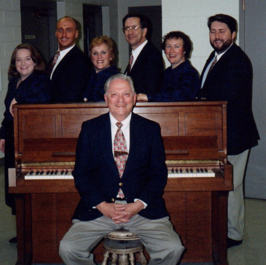 Dick Trevarthen with his choral group