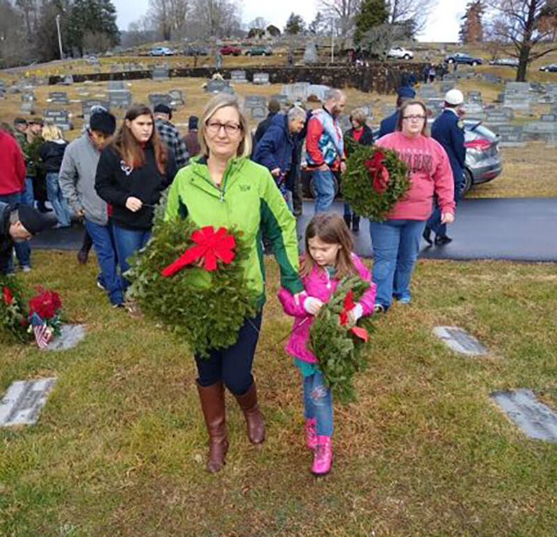 Wreaths Across America event Dec. 2019, families help place wreaths in Waynesville