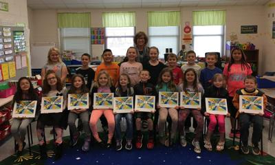 Clyde Elementary students of Sherry Justice with book