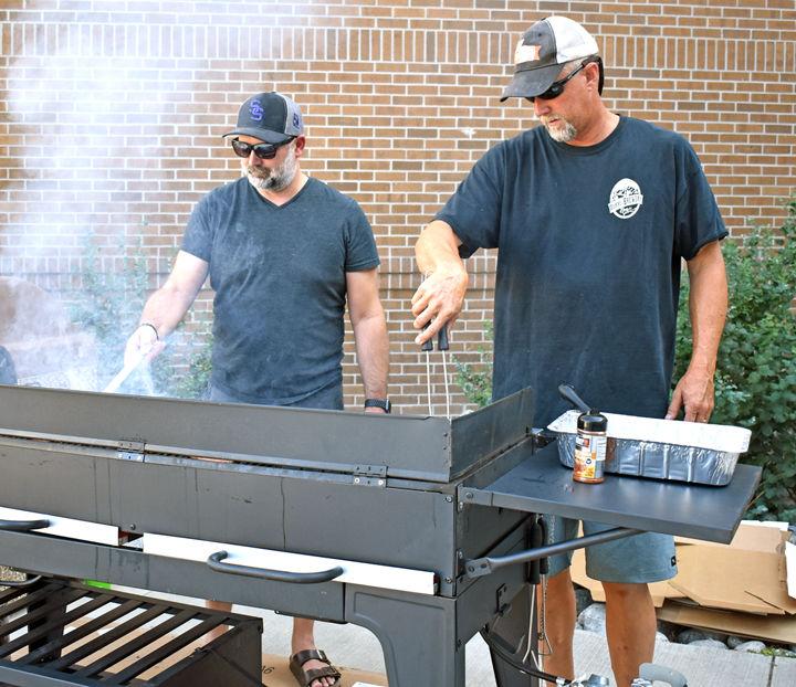 Kirk Banghart and Adam Rhude volunteer