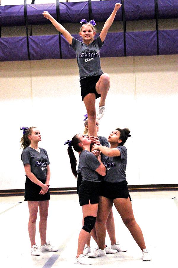 Shaylynn Gallegos balances on one foot