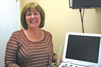 Pam Hinerman Registered Nurse And Volunteer Ultrasound Technician Shows Her Equipment For Ultrasounds Which Include A Portable Computer