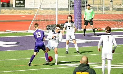 Levi Starr fights for the ball
