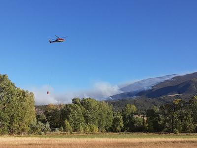 Helicopters working on the Decker Fire