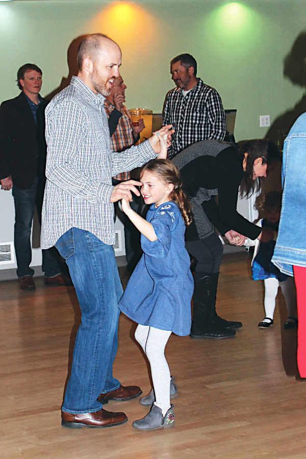 Peter Kelley dances with his daughter Leah Kelley