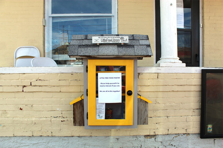 The Little Free Library in front of KHEN radio station