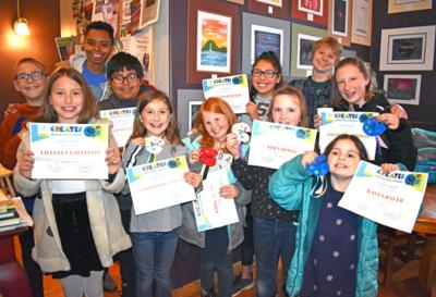 Boys & Girls Club artists hold up their certificates and ribbons