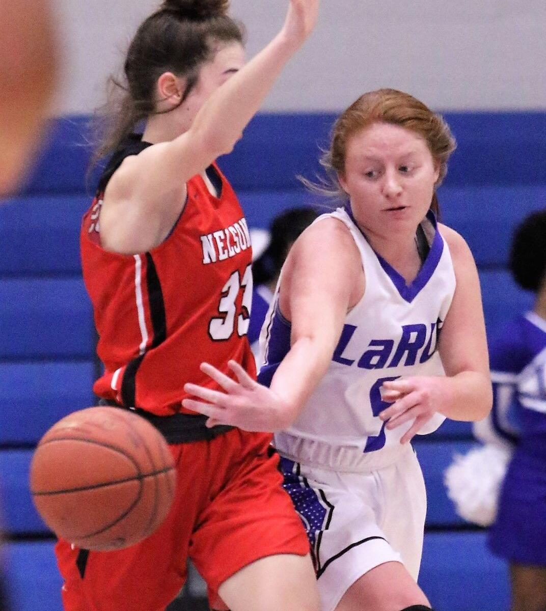 GIRLS' PREP BASKETBALL: Moore takes on added duties for Lady Hawks