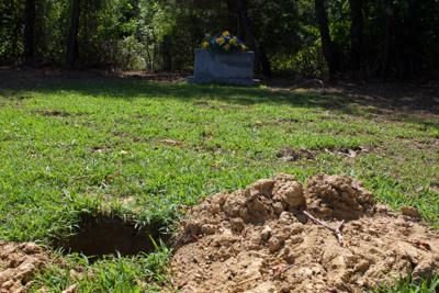 Wife's grave disturbed, urn removed