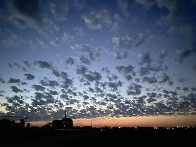 A checkered sky of clouds
