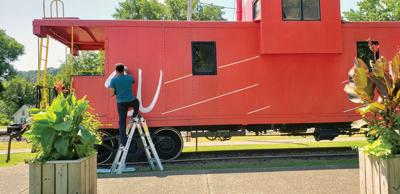 Serrano starts caboose sign in West Point