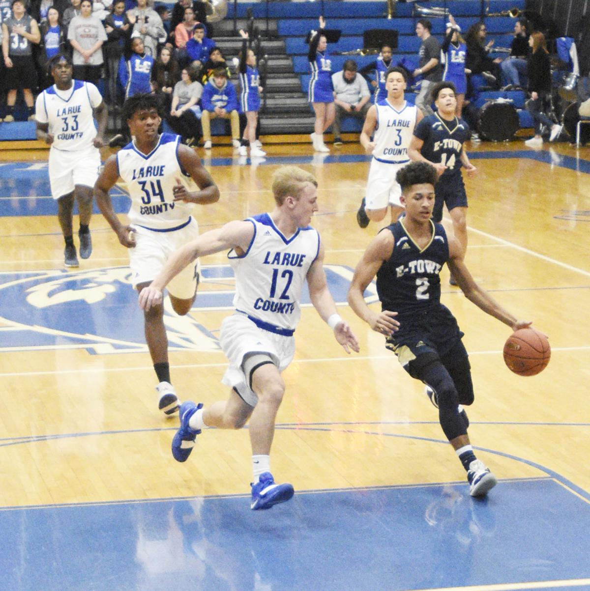 BOYS' PREP BASKETBALL: Hawks pull away to beat E'town