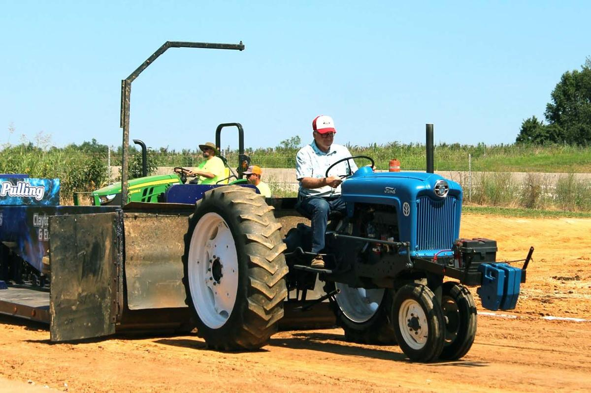 Antique tractors pull at the fair | Local News