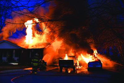 Vehicles lost, home damaged by fire