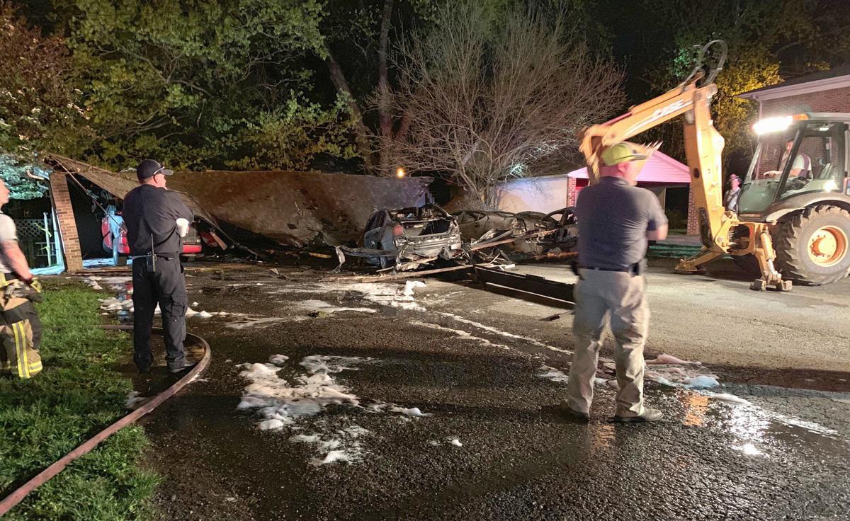 Fire destroys four vehicles, carport