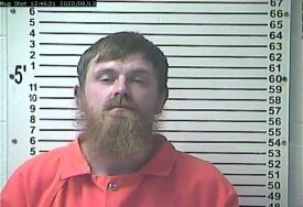 Louisville man charged with pointing gun at two people