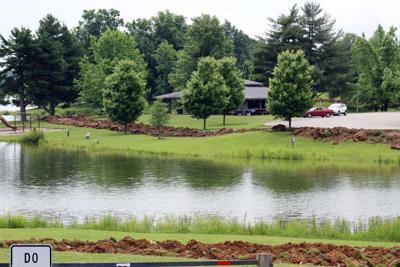 Work started to pave walking trail at lake