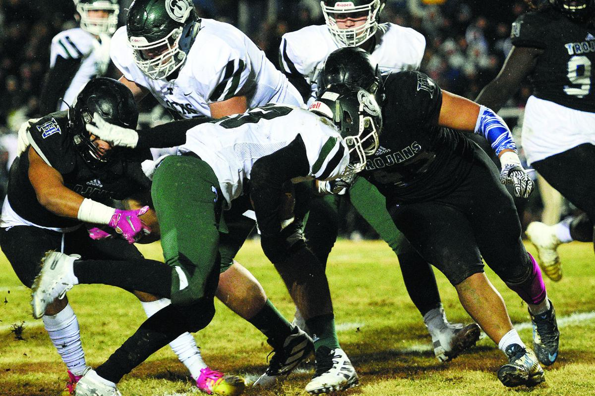PREP FOOTBALL 6-A PLAYOFFS: When it rains it pours: Trojans' errors allow Trinity to pile on points in stormy semifinal