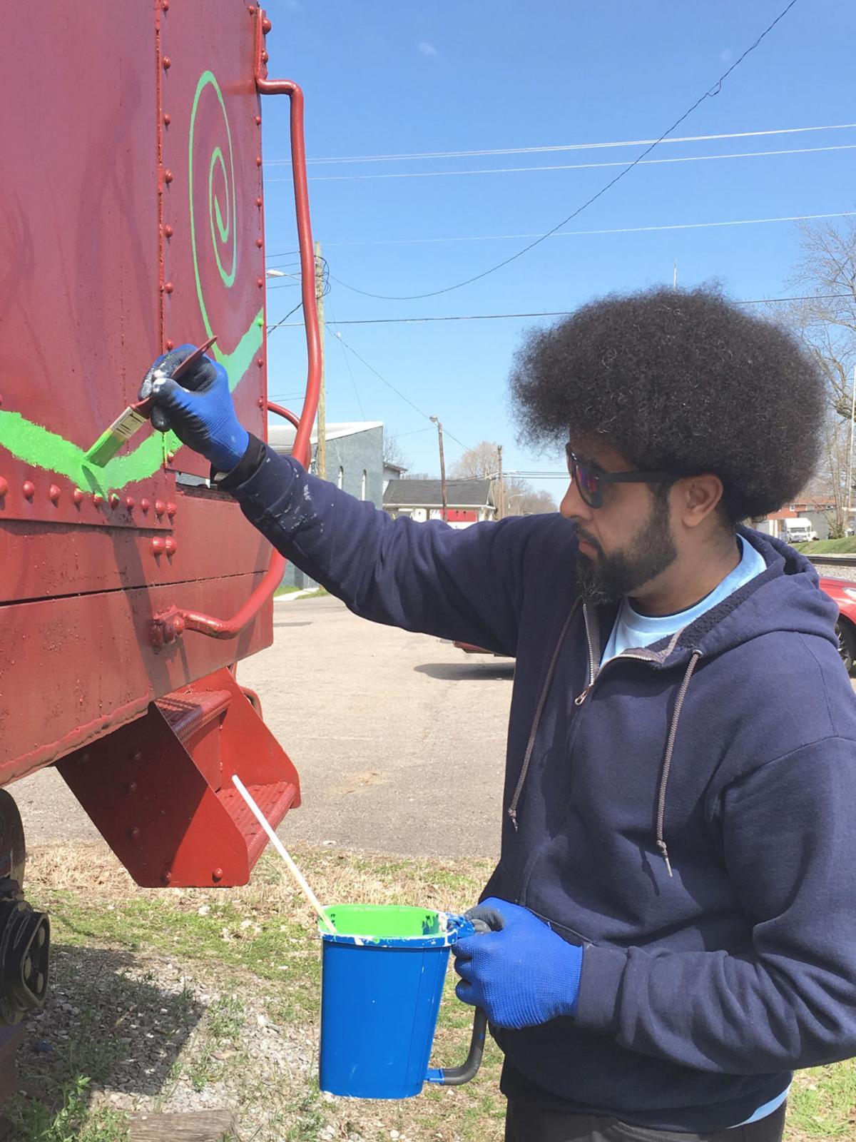 Vine Grove's caboose receives artistic makeover