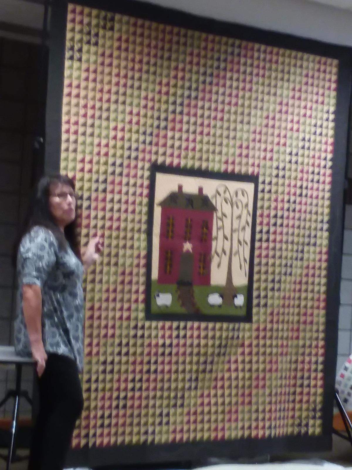 Nine Patchers Quilt Guild members gather for May meeting