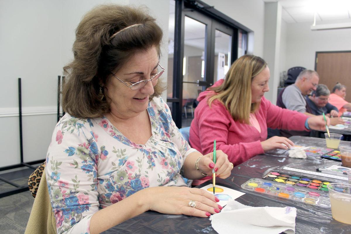 Whimsical watercolors: Residents make Christmas cards at E\'town ...