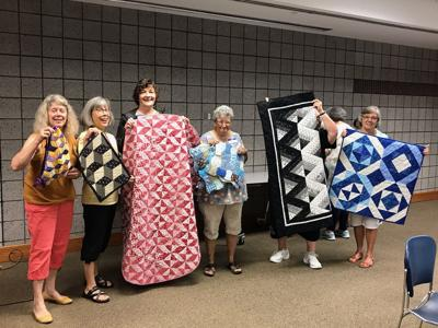 Nine Patchers Quilt Guild members accept the challenge