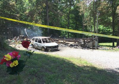 Woman's body found in burned home