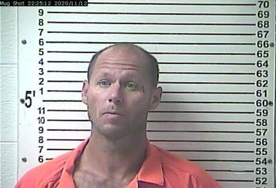 Man arrested after rollover wreck