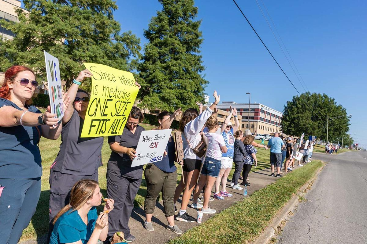 Hospital employees, supporters protest policy change