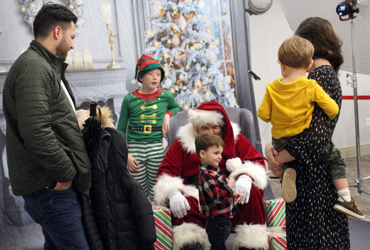 Downtown holiday activities persist in spite of heavy rain
