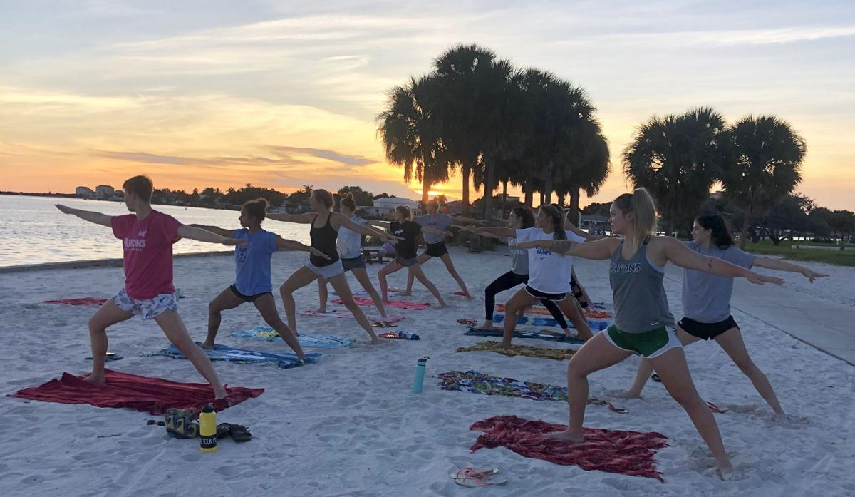 Mindful Yoga on Beach Photo