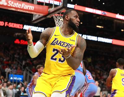 202f1b8095a Los Angeles Lakers  LeBron James looks for a foul call he didn t get against  the Atlanta Hawks during the second half on Tuesday