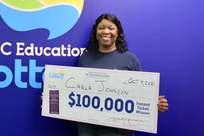 Carla Johnson claims her prize at the N.C. Education Lottery's headquarters in Raleigh.