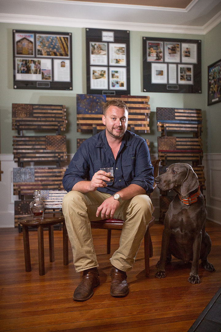 Heath Trigg And His Sidekick Luke In The New Retail Location For Heritage Flag Company Downtown Southern Pines Photograph Courtesy Of Tim Sayer