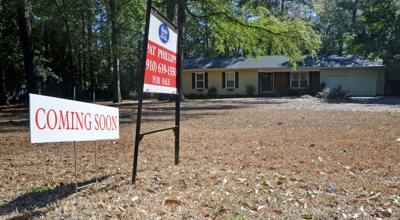 Coming soon real estate sign
