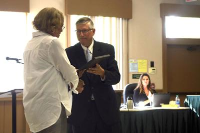 Mayor David McNeill presents a certificate to a graduate of the Southern Pines Citizens Academy