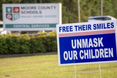 Sign posted in front of the Moore County school system's district office in Carthage on Sept. 13, 2021
