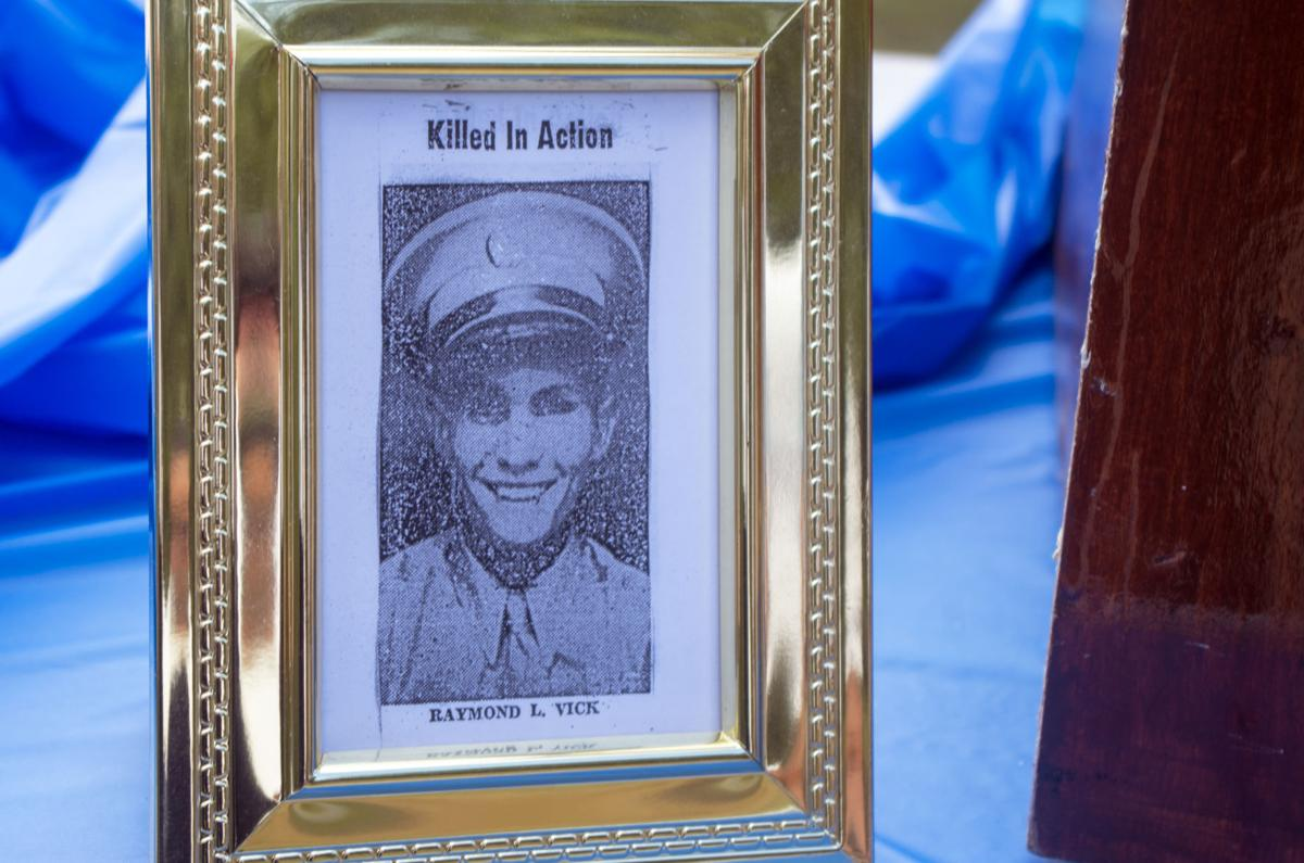 Framed newspaper clipping showing Pfc. Raymond Vick, who was killed in action during WWII